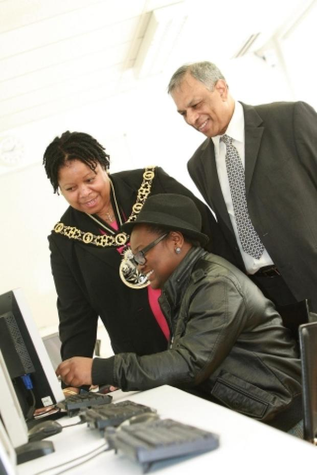 Helping hand: principal Len Sutherland, web design student Aisha Aliyu and outgoing mayor Councillor Bernice Vanier
