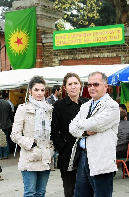 Kurdish activists camping at entrance to Finsbury Park in support of fellow activists in Turkey. Left to right: Sarra Keles, Akif Wan and Turkan Ozcan
