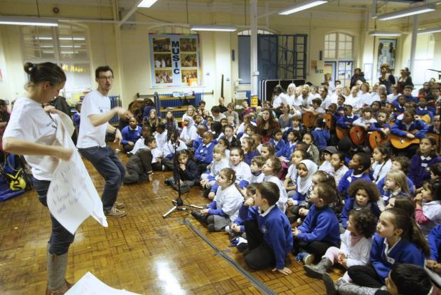 The group gathered in the school hall to record the song.