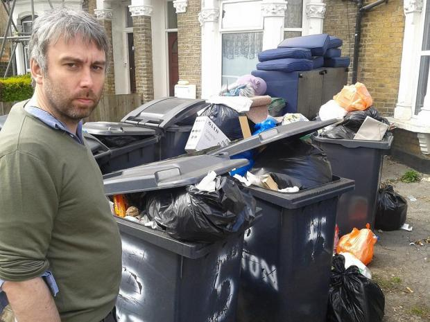 Liberal Democrat Councillor Richard Wilson with 'overflowing' bins in Caxton Road in Wood Green