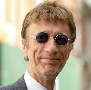 Bee Gees star Robin Gibb is fighting for his life after contracting pneumonia in his battle against cancer