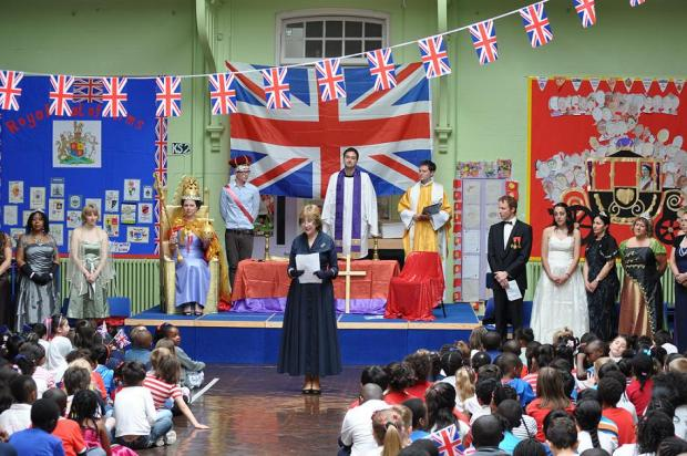 Teachers act out the Coronation in yesterday's assembly