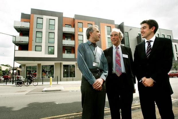 Cllr John Bevan, chairman of Newlon Housing Trust George Taylor and Cllr Alan Strickland in front of the housing development.