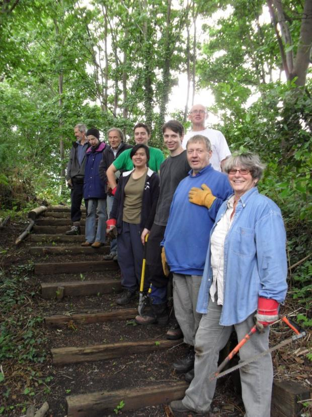 Volunteers restore hidden paths along old railway line