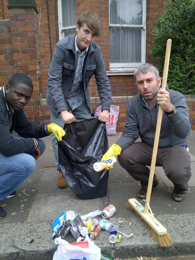 Cllr Wilson (right) cleaning the streets with volunteers