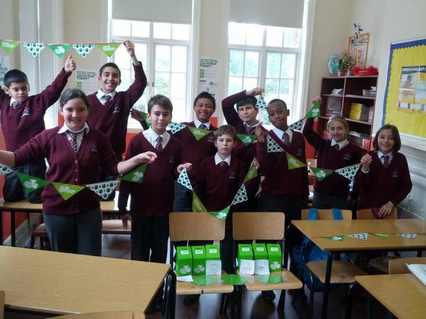 Year 7 pupils at Wisdom School make bunting for the coffee morning