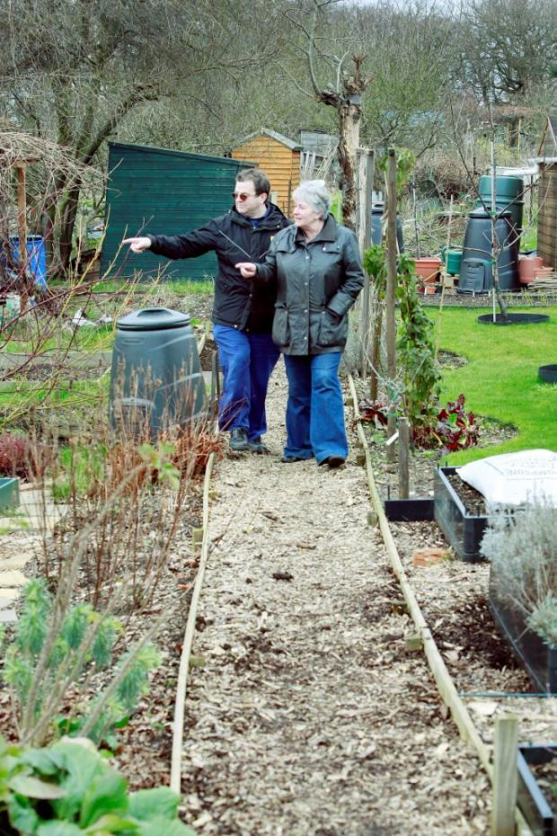 Tulio Moglia with Debby Rositer (Chair) at the Golf Course allotments