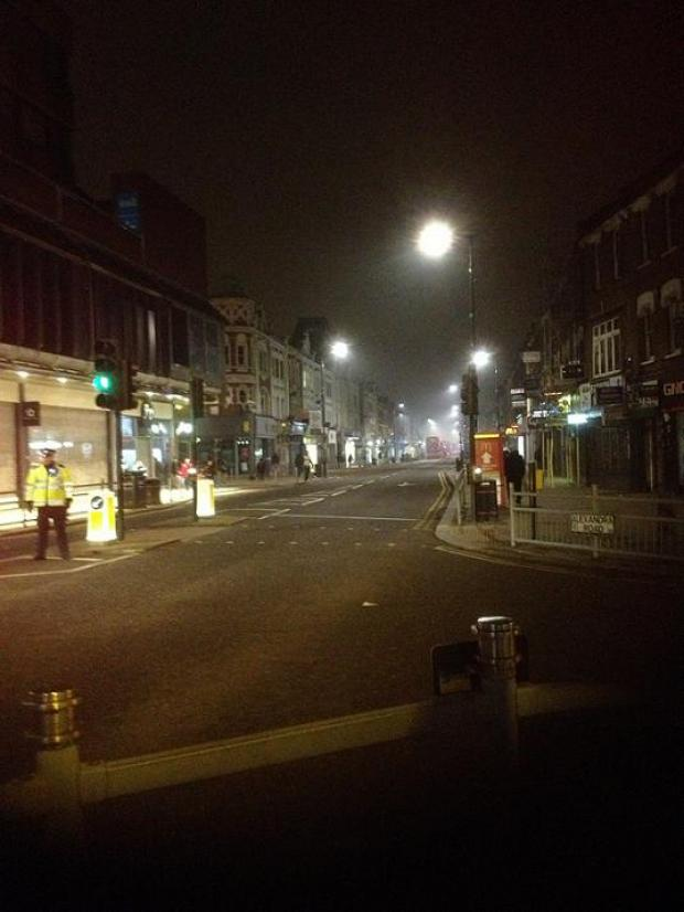 Police cleared the streets while firefighters tackle the blaze