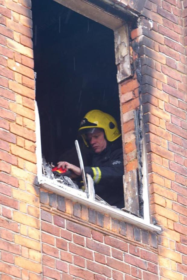 Firefighters in the burnt-out flat in High Road, Wood Green