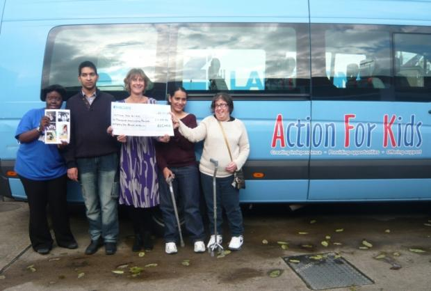 Disability charity gets cheque from company's fundraising relay