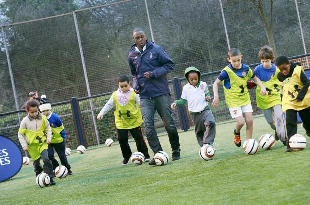 Ledley King showing children his skills in Ferry Lane Estate yesterday