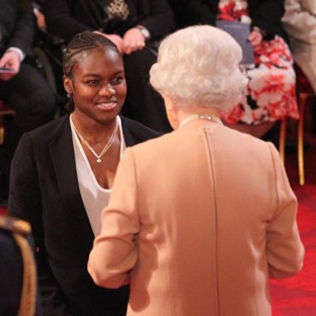 Olympic star Nicola Adams receiving her MBE from the Queen