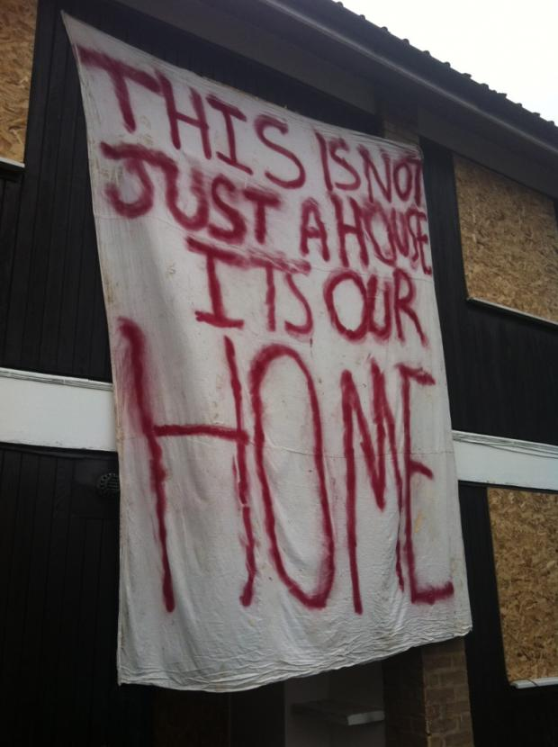 A banner hanging outside one of the homes at Connaught House