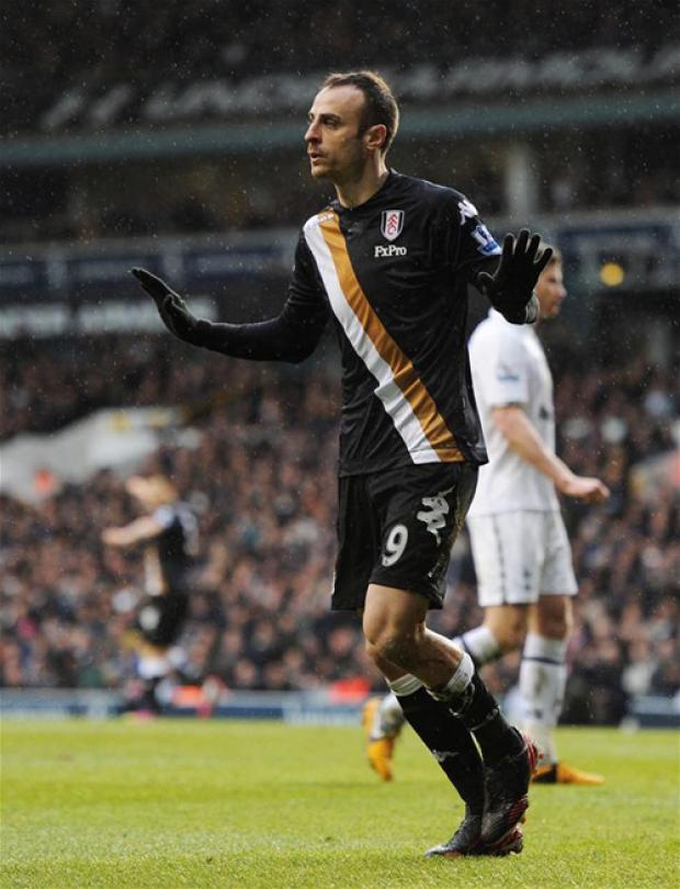 Dimitar Berbative celebrates scoring for Fulham