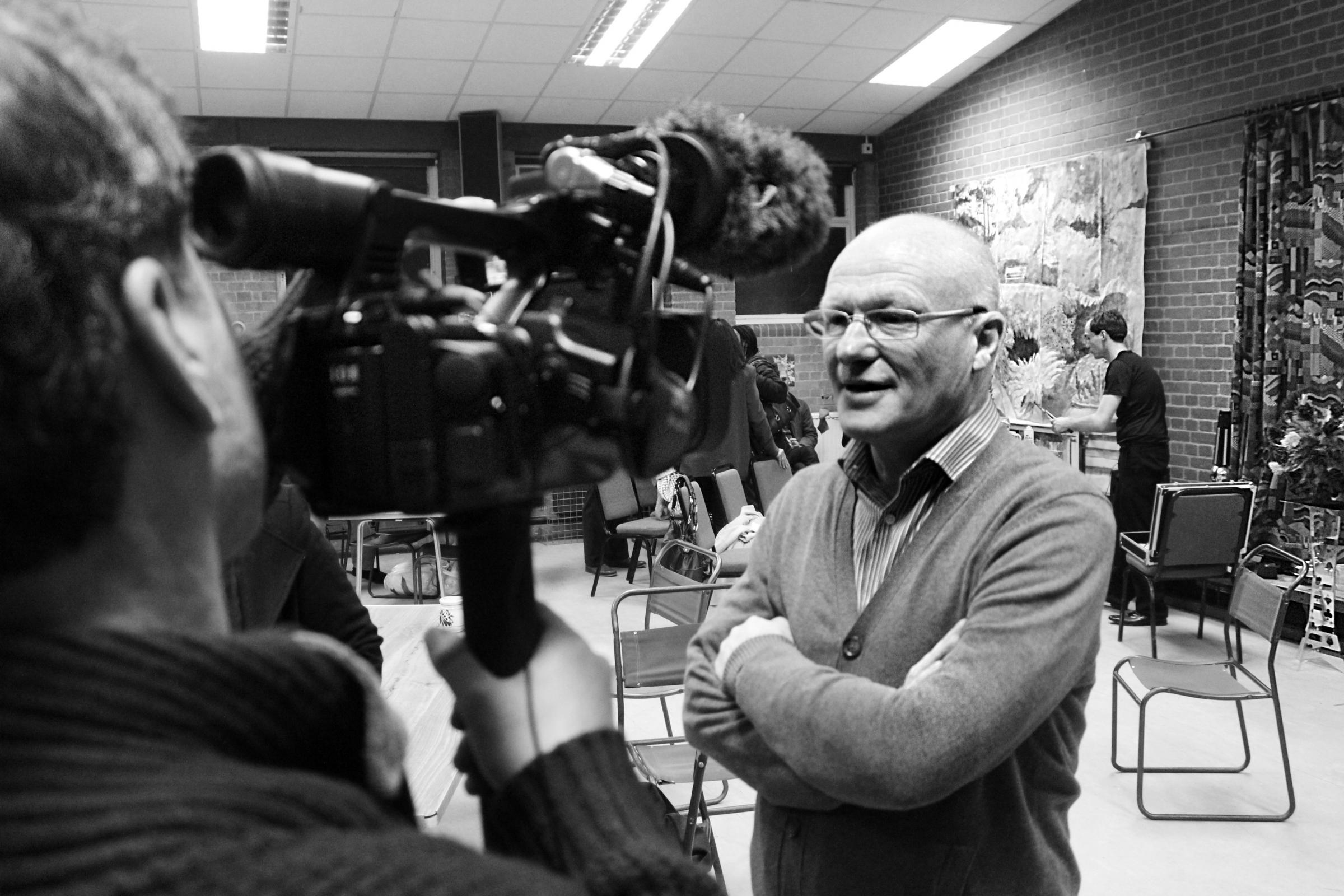 Martin Stone speaks to a camera man about the new project with the Romanian Embassy. Picture taken by Joe Beedle