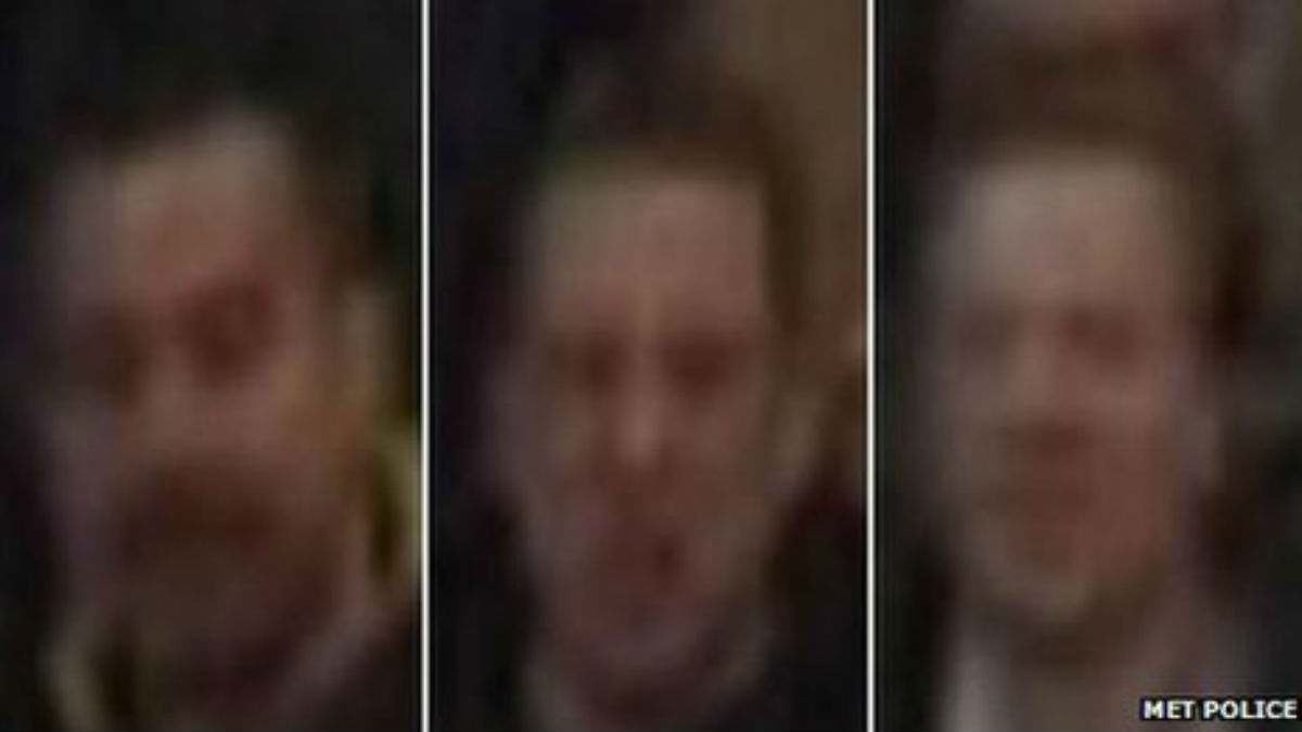 Scotland Yard has released grainy pictures of the suspects accused of throwing coins at Theo Walcott