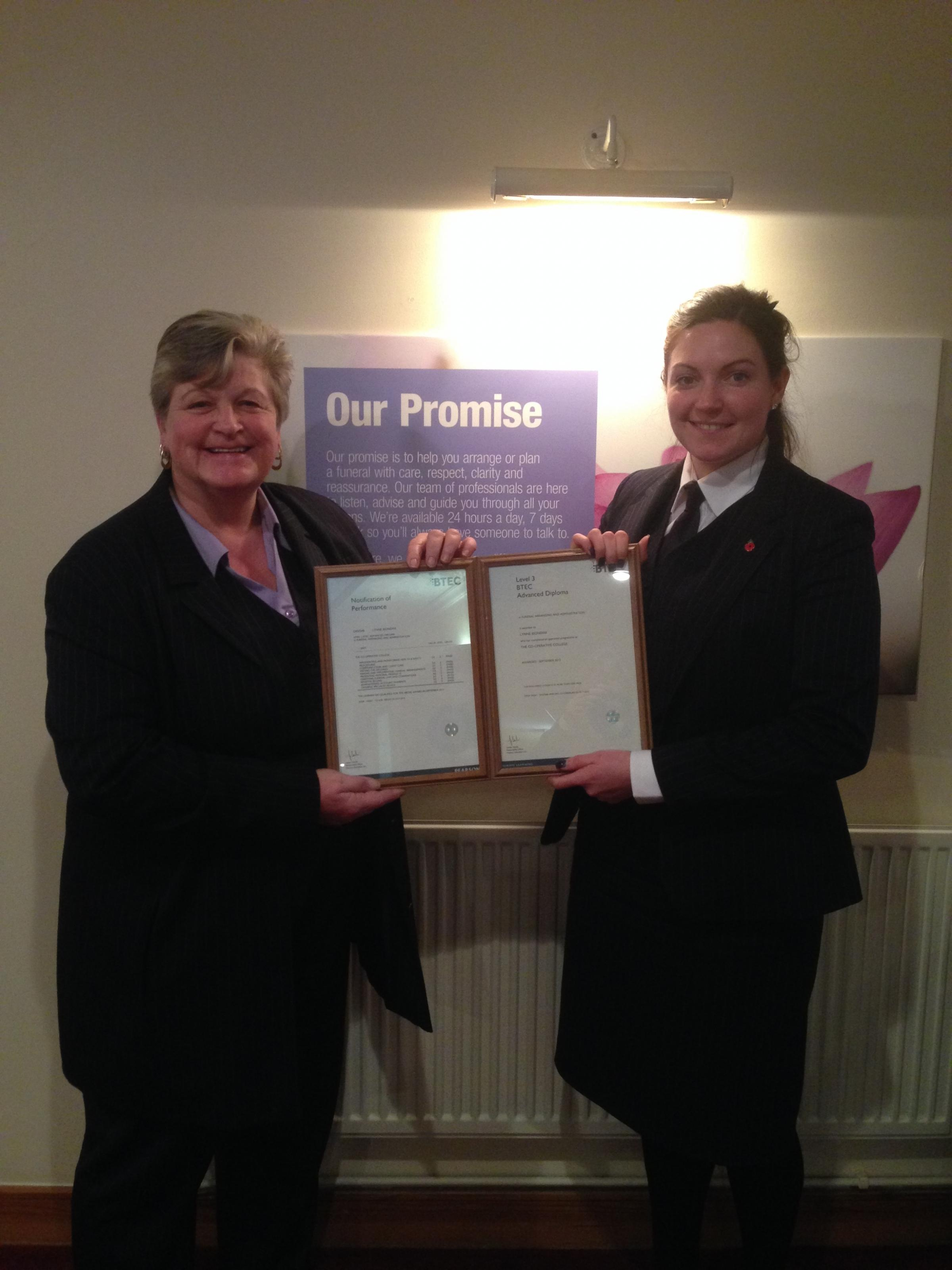 Lynne Boindini receives her certificate from manager Lynsey McBain