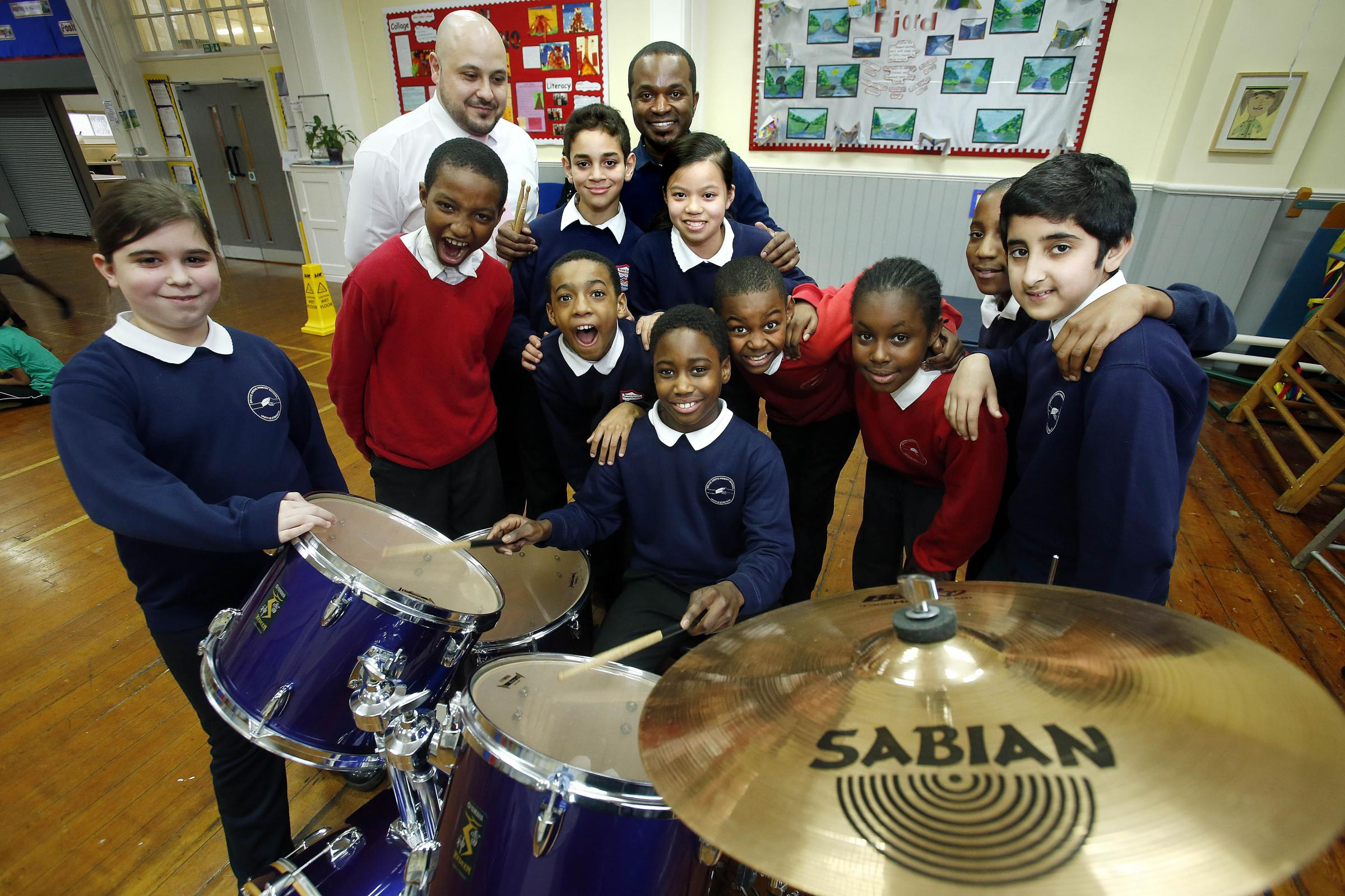 Family business donates drum kit to school