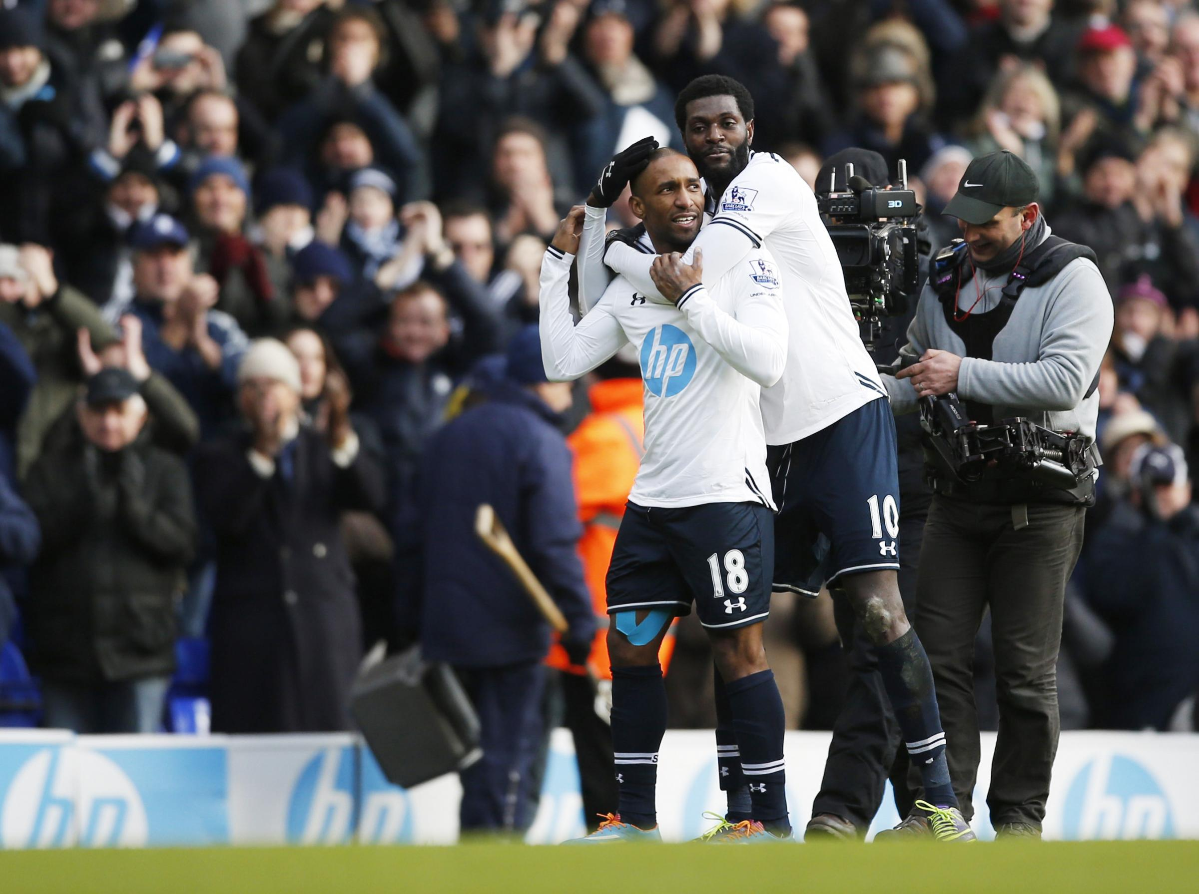 Adebayor and Defoe celebrate after the final whistle