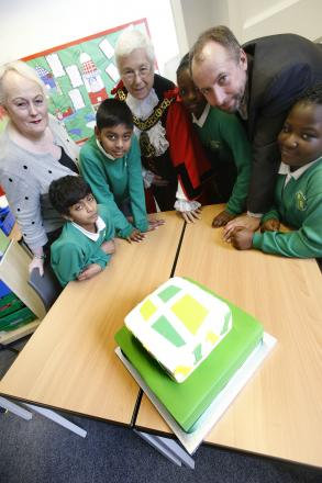 Liz Wolverson, Mayor of Harringey Sheila Peacock and Simon Kowles join pupils to cut the school's birthday cake