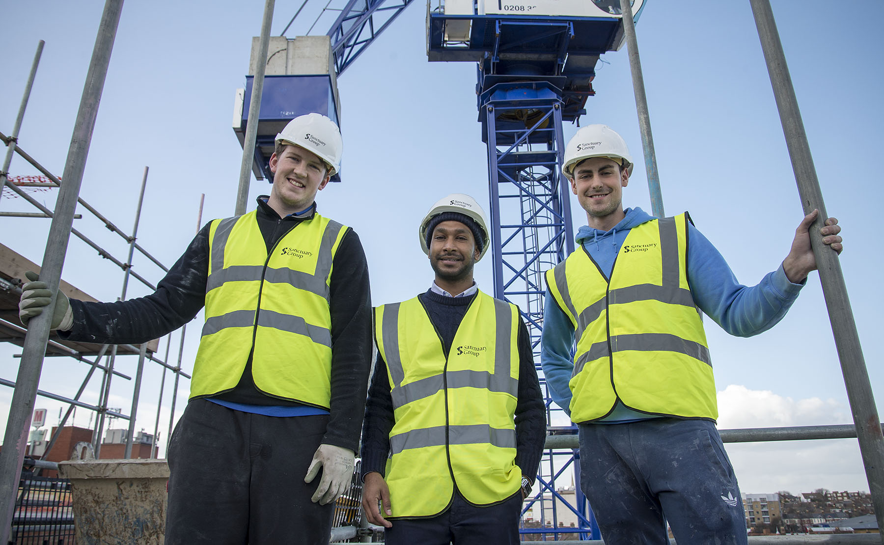 Apprentice James Marks, Sanctuary's Ali Ahmed and Apprentice Harry Carter on top of the Artisan Court development.