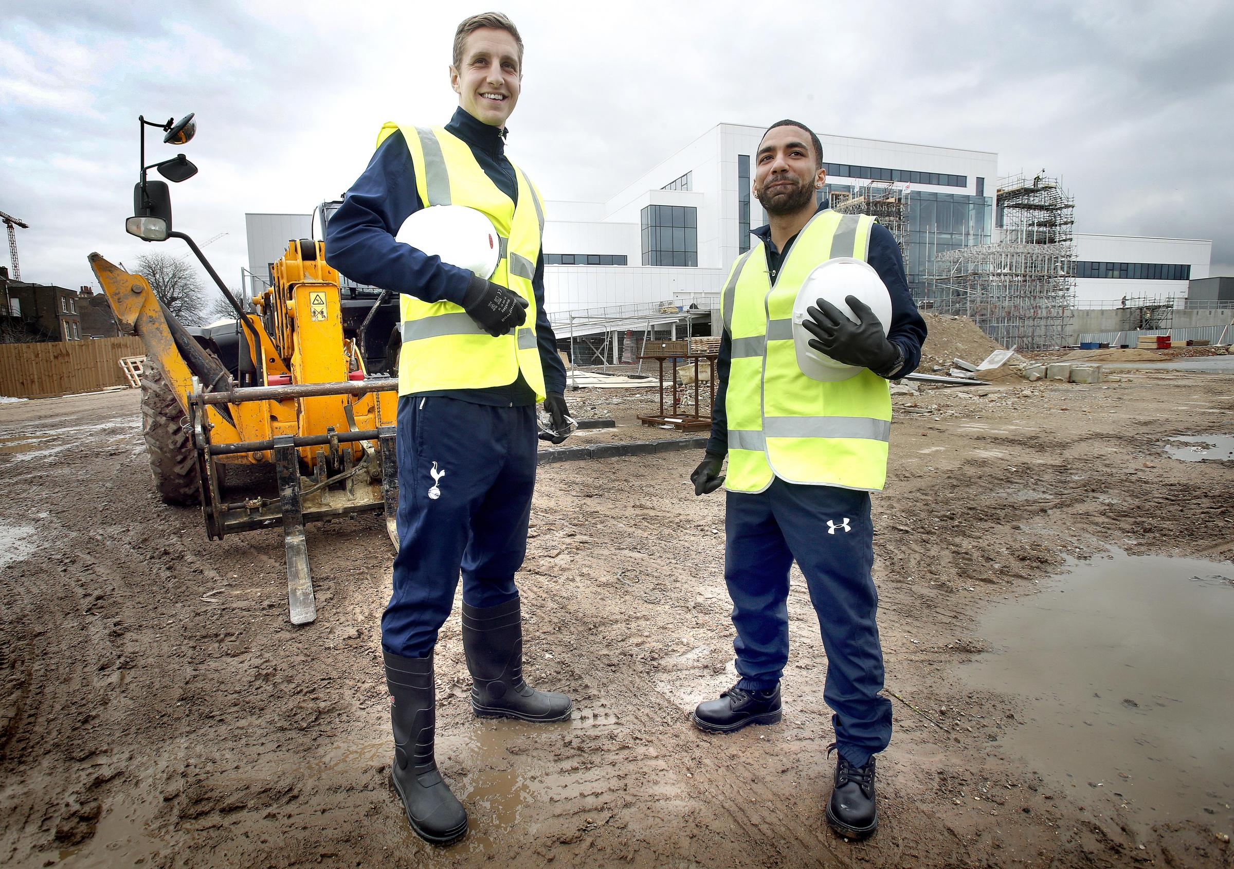 Spurs players Michael Dawson and Aaron Lennon stand on the site of where the new 56,000-seater stadium will be built