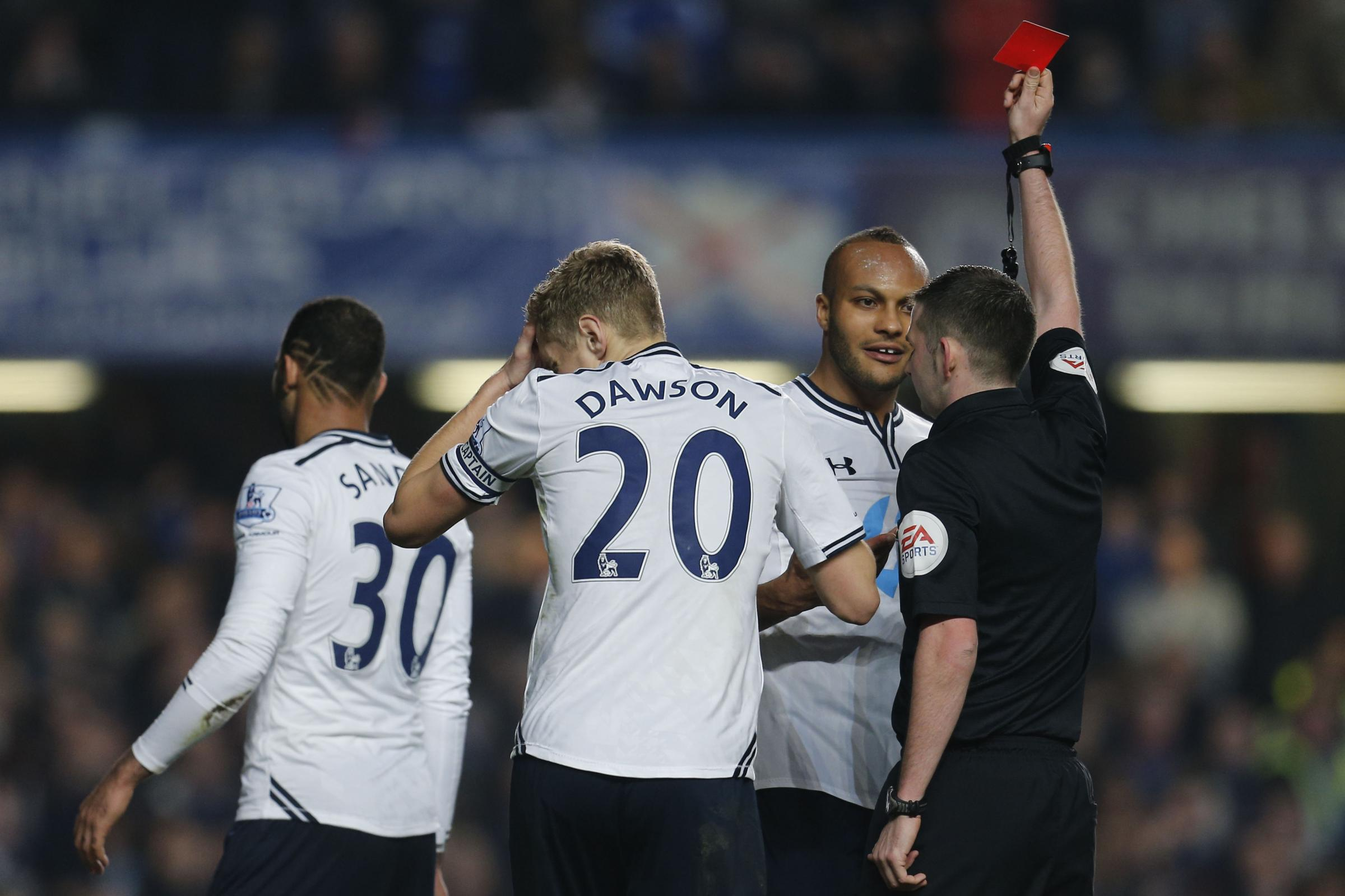 Younes Kaboul was shown red after he brought down goal scorer Samuel Eto'o inside the box