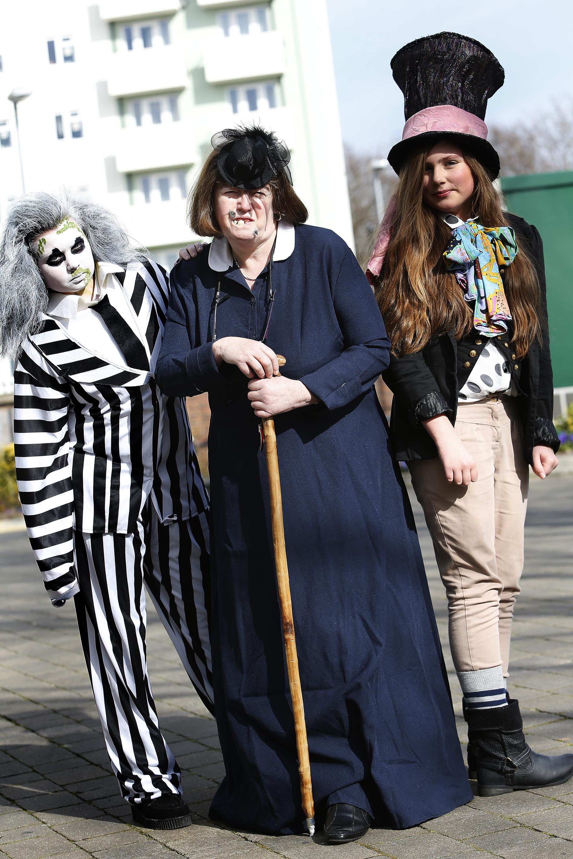 Students Megan, 14, dressed as Beetle Juice while her friend Carla, 12, dressed as the Mad Hatter. They posed for a picture with English teacher Eileen Bolton