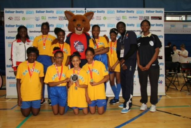 Haringey Independent: St Thomas More Catholic School's winning Year 7 team with GB sprinter Dina Asher-Smith (far left)