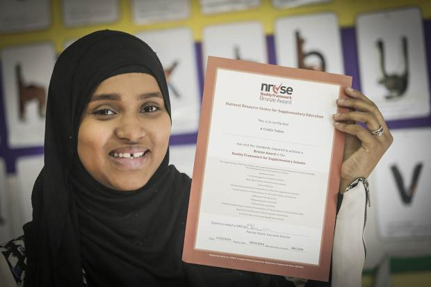 Haringey Independent: Ramla Farah, of A Class Tutors, holds the group's bronze award from the NRCSE