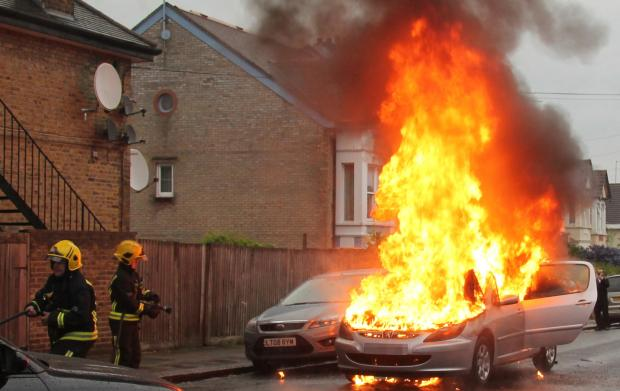 Firefighters arrived to extinguish the fireball after the baby and elderly man had been pulled from the car