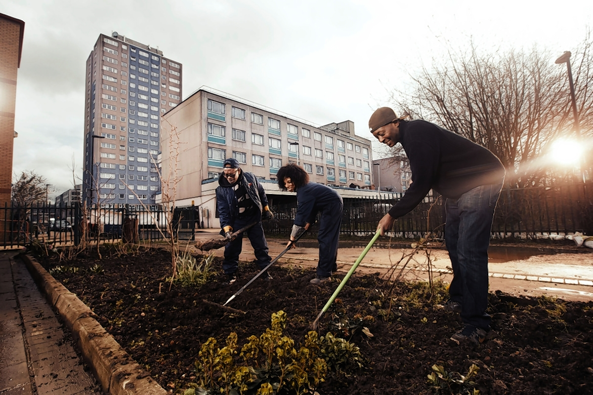 Robbie Samuda works with volunteers in the Broadwater Farm garden