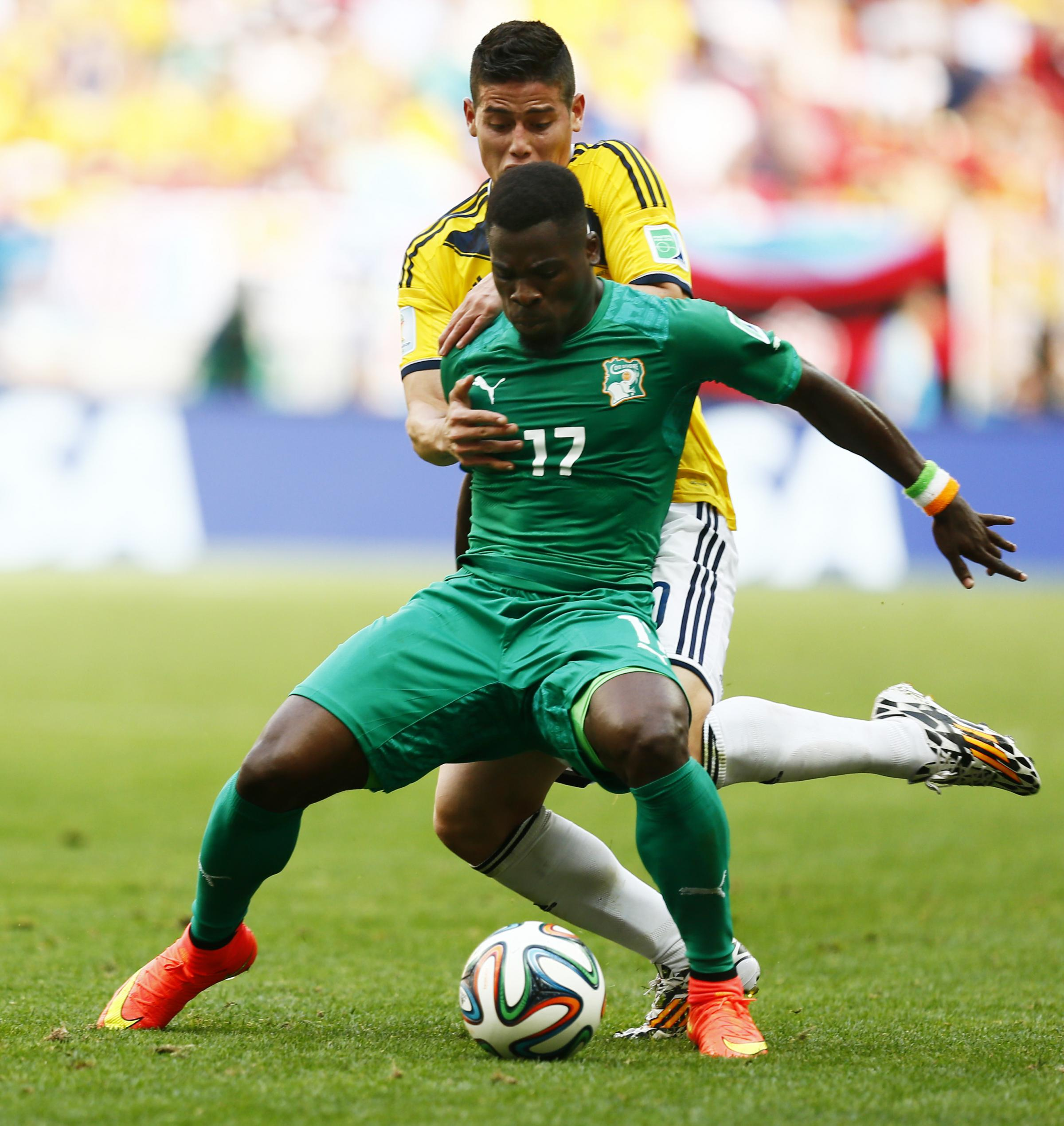 Serge Aurier holds off Colombia's James Rodriguez.