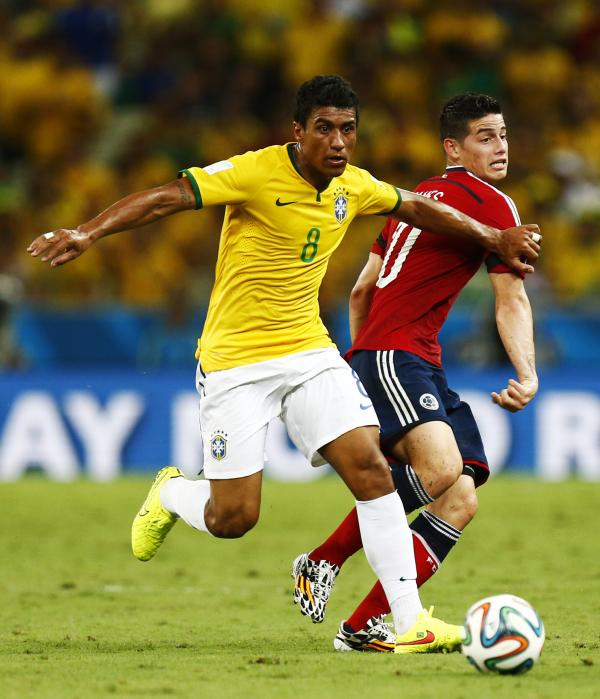 Paulinho (left) brushes aside James Rodrigez of Colombia (right). Picture: Action Images