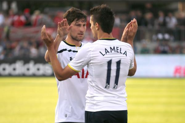 Erik Lamela celebrates one of his goals with debutant Ben Davies. Picture: Action Images