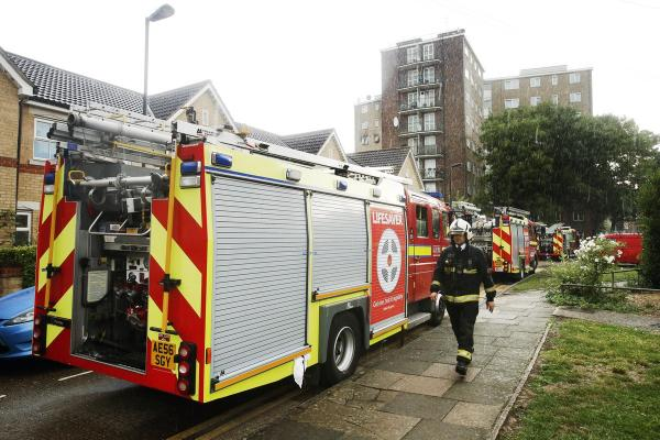 Crews outside the flat fire in Campbell Road, Tottenham