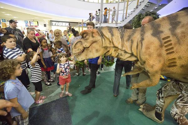 Dinosaurs storm shopping centre as holidays hit