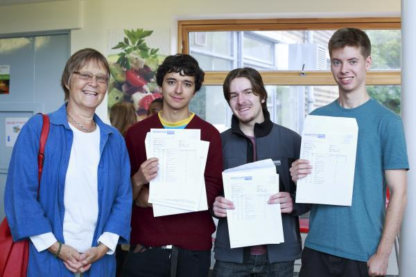 Cllr Ann Waters with Highgate Wood students Sam Timms, Niall Kennedy and Henry Notter who will be going to Bath, Bath and Bristol universities next year respectively.