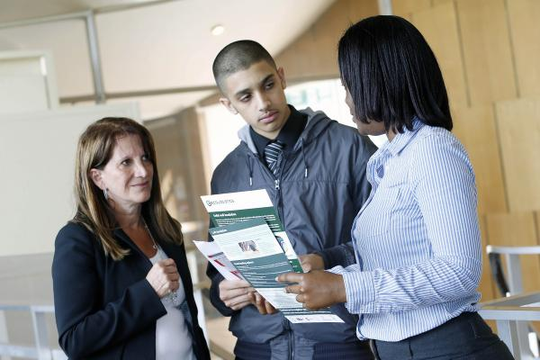 Karim Khenoussi, 18, talking with Lynne Featherstone and Golda Pearson from Ecologistics, a Wood Green home insulation company.