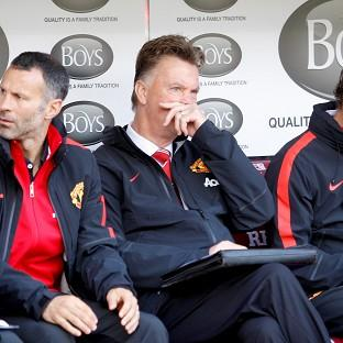 Manchester United boss Louis van Gaal, centre, endured a frustrating afternoon at Bur