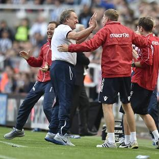 Neil Warnock celebrates his side's dramatic equal
