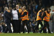 UEFA charge Spurs for pitch invasion. Action Images.