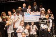 Surprise donation for performing arts school
