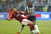 Angelo Ogbonna (right) tussles with Milan's Jeremy Menez. Picture: Action Images